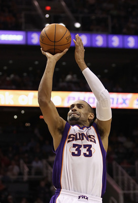 PHOENIX - DECEMBER 03:  Grant Hill #33 of the Phoenix Suns puts up a shot during the NBA game against the Indiana Pacers at US Airways Center on December 3, 2010 in Phoenix, Arizona. NOTE TO USER: User expressly acknowledges and agrees that, by downloadin