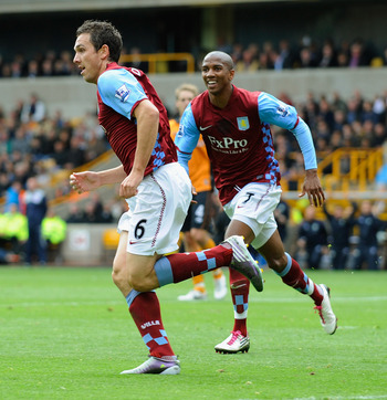 WOLVERHAMPTON, ENGLAND - SEPTEMBER 26:  Stuart Downing of Aston Villa celebrates scoring to make it 1-0 with Ashley Young during the Barclays Premier League match between Wolverhampton Wanderers and Aston Villa at Molineux on September 26, 2010 in Wolverh