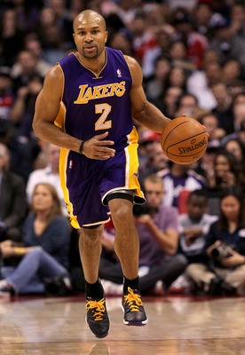 LOS ANGELES, CA - DECEMBER 8:  Derek Fisher #2 of the Los Angeles Lakers brings the ball upcourt against the Los Angeles Clippers at Staples Center on December 8, 2010 in Los Angeles, California.  NOTE TO USER: User expressly acknowledges and agrees that,
