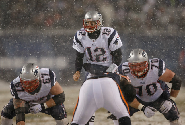 CHICAGO, IL - DECEMBER 12: Tom Brady #12 of the New England Patriots calls out signals as Dan Koppen #67 and Logan Mankins #70 awaits the snap against the Chicago Bears at Soldier Field on December 12, 2010 in Chicago, Illinois. The Patriots defeated the