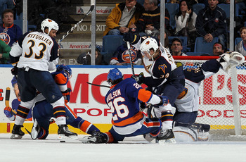 UNIONDALE, NY - DECEMBER 11:  Dustin Byfuglien #33 and Tobias Enstrom #39 of the Atlanta Thrashers defend against John Tavares #91 and Matt Moulson #26 of the New York Islanders on December 11, 2010 at Nassau Coliseum in Uniondale, New York. The Thrashers