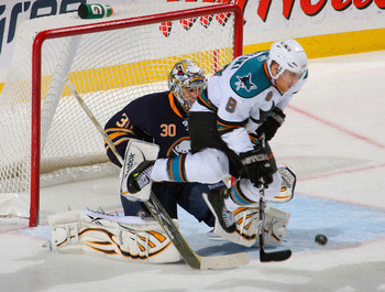 BUFFALO, NY - DECEMBER 09: Ryan Miller #30 of the Buffalo Sabres is screened by a jumping Joe Pavelski #8 of the San Jose Sharks on a goal by Douglas Murray #3 of the Sharks (not shown) at HSBC Arena on December 9, 2010 in Buffalo, New York. Buffalo won 6