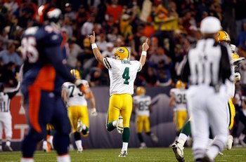 DENVER - OCTOBER 29: Quarterback Brett Favre #4 of the Green Bay Packers celebrates a play against the Denver Broncos at Invesco Field at Mile High on September 23, 2007 in Denver, Colorado. The Jaguars won 23-14  (Photo by Allen Kee/Getty Images)