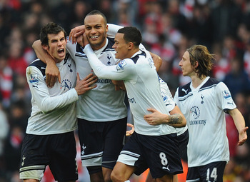 LONDON, ENGLAND - NOVEMBER 20:  Younes Kaboul of Tottenham celebrates with team mates Gareth Bale and Jermaine Jenas after scoring the winner during the Barclays Premier League match between Arsenal and Tottenham Hotspur at the Emirates Stadium on Novembe