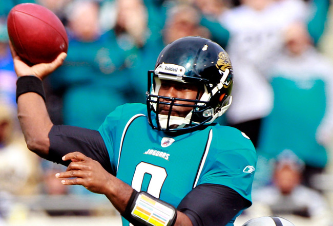 JACKSONVILLE, FL - DECEMBER 12:  Quarterback David Garrard #9 of the Jacksonville Jaguars attempts a pass while being pressured by Lamarr Houston #99 of the Oakland Raiders at EverBank Field on December 12, 2010 in Jacksonville, Florida.  (Photo by Sam Gr
