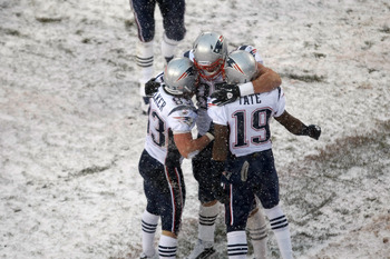 CHICAGO, IL - DECEMBER 12: Rob Gronkowski #87 of the New England Patriots celebrates a touchdown with Golden Tate #19 and Wes Welker #83 against the Chicago Bears at Soldier Field on December 12, 2010 in Chicago, Illinois. The Patriots defeated the Bears