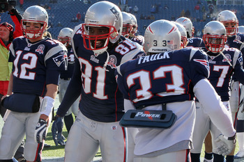 FOXBORO, MA - JANUARY 10:  Tom Brady #12 and Randy Moss #81 of the New England Patriots greet their teammates on the field during warm ups against the Baltimore Ravens during the 2010 AFC wild-card playoff game at Gillette Stadium on January 10, 2010 in F