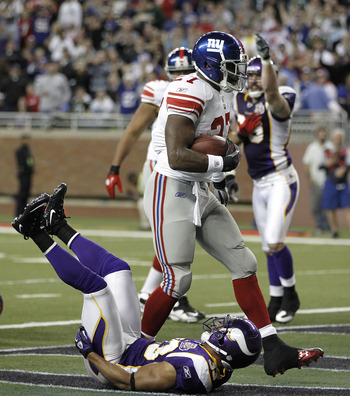 DETROIT, MI - DECEMBER 13:  Brandon Jacobs #27 of the New York Giants scores a second quarter touchdown over Jamarca Sanford #33 of the Minnesota Vikings at Ford Field on December 13, 2010 in Detroit, Michigan.  (Photo by Gregory Shamus/Getty Images)