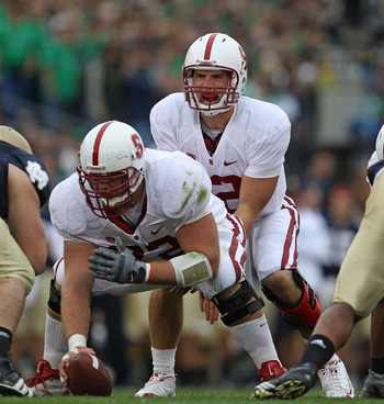 SOUTH BEND, IN - SEPTEMBER 25: Andrew Luck #12 of the Stanford Cardinal calls the signals as Chase Beeler #72 prepares to snap the ball against the Notre Dame Fighting Irish at Notre Dame Stadium on September 25, 2010 in South Bend, Indiana. Stanford defe