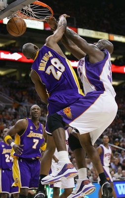 PHOENIX - FEBRUARY 20:   Shaquille O'Neal #32 of the Phoenix Suns slam dunks against DJ Mbenga #28 of the Los Angeles Lakers at US Airways Center on February 20, 2008 in Phoenix, Arizona.  NOTE TO USER: User expressly acknowledges and agrees that, by down
