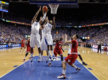 LEXINGTON, KY - DECEMBER 11:  Terrence Jones #3 and DeAndre Liggins #32 of the Kentucky Wildcats grab a rebound during the 81-62 victory over the Indiana Hoosiers on December 11, 2010 in Lexington, Kentucky.  (Photo by Andy Lyons/Getty Images)