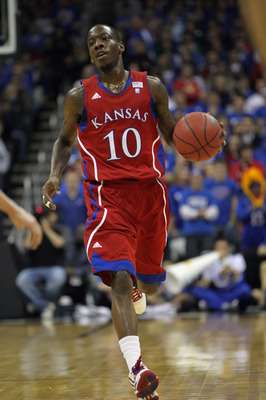 KANSAS CITY, MO - DECEMBER 11:  Tyshawn Taylor #10 of the Kansas Jayhawks in action during the game against the Colorado State Rams on December 11, 2010 at the Sprint Center in Kansas City, Missouri.  (Photo by Jamie Squire/Getty Images)