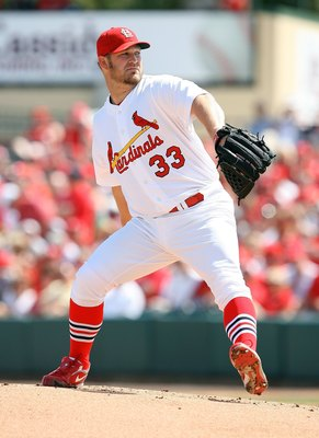 JUPITER, FL - MARCH 10:  Starting pitcher Brad Penny #33 of the St Louis Cardinals pitches against the Washington Nationals at Roger Dean Stadium on March 10, 2010 in Jupiter, Florida.  (Photo by Doug Benc/Getty Images)
