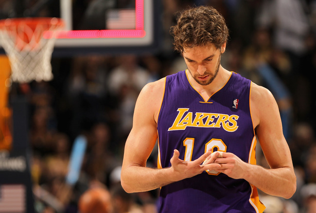 DENVER - NOVEMBER 11:  Pau Gasol #16 of the Los Angeles Lakers leaves the court after the Lakers were defeated by the Denver Nuggets at the Pepsi Center on November 11, 2010 in Denver, Colorado. The Nuggets defeated the Lakers 118-112.  NOTE TO USER: User