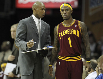 CLEVELAND - OCTOBER 27:  Head coach Byron Scott of the Cleveland Cavaliers talks over a play with Daniel Gibson #1 while playing the Boston Celtics at Quicken Loans Arena on October 27, 2010 in Cleveland, Ohio. Cleveland won the game 95-87. (Photo by Greg