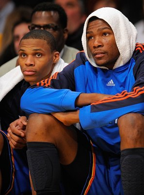 LOS ANGELES, CA - APRIL 27:  (L-R) Russell Westbrook #0 and Kevin Durant #35 of the Oklahoma City Thunder sit on the bench late in the fourth quarter while taking on the Los Angeles Lakers during Game Five of the Western Conference Quarterfinals of the 20
