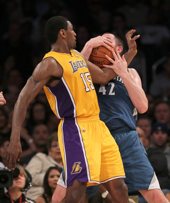 LOS ANGELES - NOVEMBER 9: Ron Artest #15 of the Los Angeles Lakers battles for a loose ball with Kevin Love #42 of the Minnesota Timberwolves at Staples Center on November 9, 2010 in Los Angeles, California.  The Lakers won 99-94.  NOTE TO USER: User expr