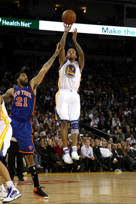 OAKLAND, CA - NOVEMBER 19:  Monta Ellis #8 of the Golden State Warriors in action against the New York Knicks at Oracle Arena on November 19, 2010 in Oakland, California. NOTE TO USER: User expressly acknowledges and agrees that, by downloading and or usi