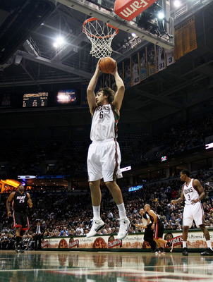 MILWAUKEE, WI - DECEMBER 06: Andrew Bogut #6 of the Milwaukee Bucks grabs a rebound against the Miami Heat at the Bradley Center on December 6, 2010 in Milwaukee, Wisconsin. The Heat defeated the Bucks 88-78. NOTE TO USER: User expressly acknowledges and