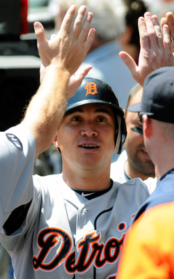 MINNEAPOLIS, MN - JUNE 30: Magglio Ordonez #30 of the Detroit Tigers celebrates scoring with his teammates in the fourth inning against the Minnesota Twins during their game on June 30, 2010 at Target Field in Minneapolis, Minnesota. (Photo by Hannah Fosl