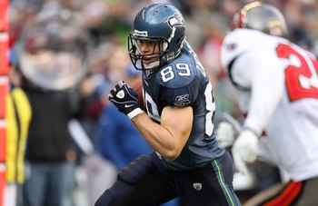 SEATTLE - DECEMBER 20:  John Carlson #89 of the Seattle Seahawks runs with the ball for yardage during their game against the Tampa Bay Buccaneers on December 20, 2009 at Qwest Field in Seattle, Washington. The Buccaneers defeated the Seahawks 24-7. (Phot