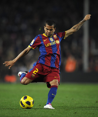 BARCELONA, SPAIN - DECEMBER 12:  Dani Alves of Barcelona shoots at goal during the La Liga match between Barcelona and Real Sociedad at Camp Nou Stadium on December 12, 2010 in Barcelona, Spain. Barcelona won 5-0.  (Photo by David Ramos/Getty Images)