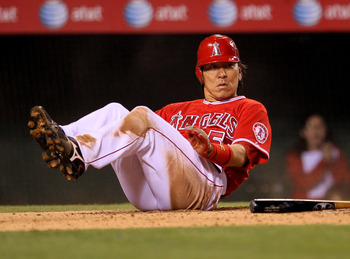 ANAHEIM, CA - SEPTEMBER 21:  Hideki Matsui #55 of the Los Angeles Angels of Anaheim slides into home to score a run on a fielder's choice in the fourth inning against the Texas Rangers on September 21, 2010 at Angel Stadium in Anaheim, California.  (Photo