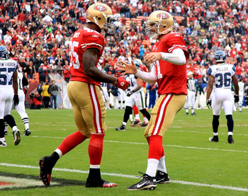 SAN FRANCISCO - DECEMBER 12:    Vernon Davis #85 of the San Francisco 49ers celebrates with Alex Smith #11 after a catching a touchdown against the Seattle Seahawks during an NFL game at Candlestick Park on December 12, 2010 in San Francisco, California.