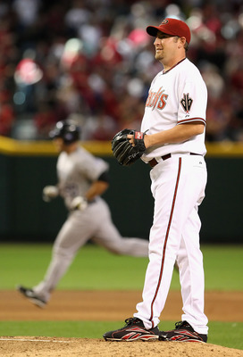 PHOENIX - APRIL 06:  Starting pitcher Brandon Webb #17 of the Arizona Diamondbacks reacts after giving up a solo home run to Chris Iannetta #20 of the Colorado Rockies during the MLB openning day game at Chase Field on April 6, 2009 in Phoenix, Arizona.