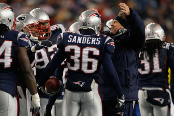 FOXBORO, MA - DECEMBER 06:  James Sanders #36 and head coach Bill Belichick of the New England Patriots celebrate after Sanders intercepted a pass against the New York Jets at Gillette Stadium on December 6, 2010 in Foxboro, Massachusetts.  (Photo by Jim
