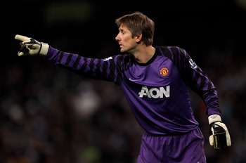 MANCHESTER, ENGLAND - NOVEMBER 10:  Edwin van der Sar of Manchester United gestures during the Barclays Premier League match between Manchester City and Manchester United at the City of Manchester Stadium on November 10, 2010 in Manchester, England.  (Pho