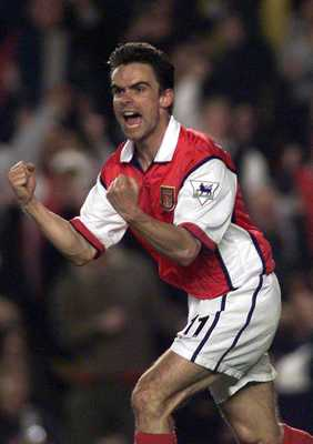 2 May 2000:  Marc Overmars of Arsenal celebrates scoring the equalizing goal  during the match between Arsenal and West Ham United in the FA Carling Premiership at Highbury, London.  Mandatory Credit: Laurence Griffiths/ALLSPORT