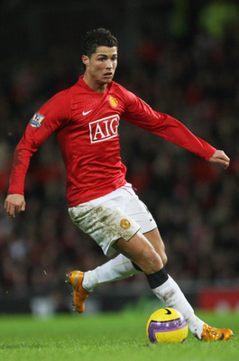 MANCHESTER, UNITED KINGDOM - JANUARY 12:  Cristiano Ronaldo of Manchester runs with the ball during the Barclays Premier League match between Manchester United and Newcastle United at Old Trafford on January 12, 2008 in Manchester, England.  (Photo by Ale