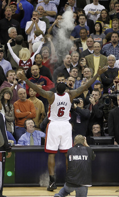 CLEVELAND, OH - DECEMBER 02:  LeBron James #6 of the Miami Heat throws powder in the air prior to playing the Cleveland Cavaliers at Quicken Loans Arena on December 2, 2010 in Cleveland, Ohio. NOTE TO USER: User expressly acknowledges and agrees that, by