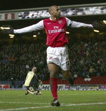 BLACKBURN, UNITED KINGDOM - JANUARY 13: Thierry Henry of Arsenal celebrates scoring his team's second goal during the Barclays Premiership match between Blackburn Rovers and Arsenal at Ewood Park on January 13, 2007 in Blackburn, England. (Photo by Lauren