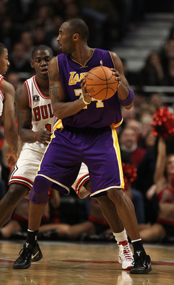 CHICAGO, IL - DECEMBER 10: Kobe Bryant #24 of the Los Angeles Lakers looks to pass as Ronnie Brewer #11 of the Chicago Bulls defends at the United Center on December 10, 2010 in Chicago, Illinois. The Bulls defeated the Lakers 88-84. NOTE TO USER: User ex