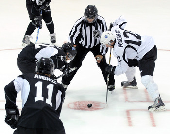 TORONTO, ON - AUGUST 18: Jonathan Huberdeau, #12 (white), takes a face-off where new face-off violation lines were tested by the NHL during an on-ice session at the 2010 NHL Research, Development and Orientation Camp fueled by G Series on August 18, 2010