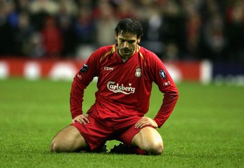 LIVERPOOL, UNITED KINGDOM - MARCH 08: Fernando Morientes of Liverpool looks dejectedly at the turf during the last 16 2nd leg UEFA Champions League match between Liverpool and Benfica at Anfield on March 8, 2006 in Liverpool, England. (Photo by Alex Lives