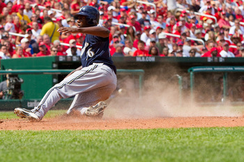 ST. LOUIS - AUGUST 18: Lorenzo Cain #36 of the Milwaukee Brewers scores a run against the St. Louis Cardinals at Busch Stadium on August 18, 2010 in St. Louis, Missouri.  The Brewers beat the Cardinals 3-2.  (Photo by Dilip Vishwanat/Getty Images)