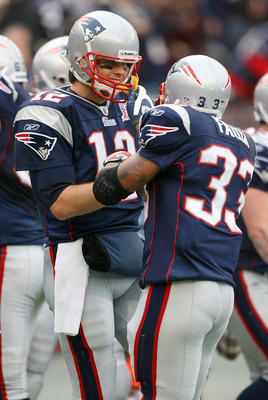 FOXBORO, MA - DECEMBER 27:  Tom Brady #12 of the New England Patriots celebrates with Kevin Faulk #33 after Brady threw a second touchdown pass to Randy Moss against the Jacksonville Jaguars at Gillette Stadium on December 27, 2009 in Foxboro, Massachuset
