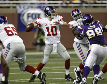 DETROIT, MI - DECEMBER 13:  Eli Manning #10 of the New York Giants throws a second quarter pass while playing the Minnesota Vikings at Ford Field on December 13, 2010 in Detroit, Michigan.  (Photo by Gregory Shamus/Getty Images)