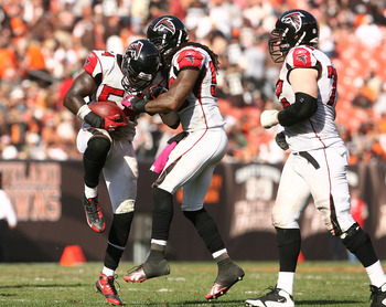 CLEVELAND - OCTOBER 10:  Linebacker Stephen Nicholas #54 (L) of the Atlanta Falcons celebrates with Curtis Lofton #50 and Sam Baker #72 after intercepting the ball against  the Cleveland Browns at Cleveland Browns Stadium on October 10, 2010 in Cleveland,