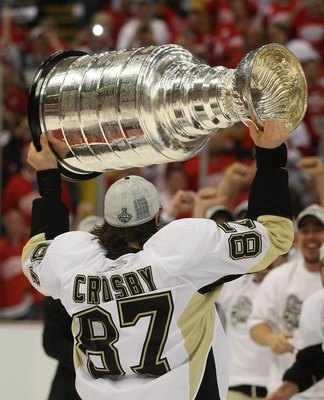 DETROIT - JUNE 12:  Sidney Crosby #87 of the Pittsburgh Penguins holds the Stanley Cup following the Penguins victory over the Detroit Red Wings in Game Seven of the 2009 NHL Stanley Cup Finals at Joe Louis Arena on June 12, 2009 in Detroit, Michigan.  (P