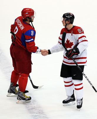 VANCOUVER, BC - FEBRUARY 24:  (L-R) Alexander Ovechkin #8 of Russia shakes hands with Sidney Crosby #87 of Canada after Canada's 7-3 victory during the ice hockey men's quarter final game between Russia and Canada on day 13 of the Vancouver 2010 Winter Ol