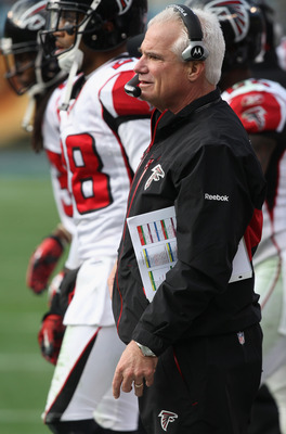 CHARLOTTE, NC - DECEMBER 12:  Head coach Mike Smith of the Atlanta Falcons watches on against the Carolina Panthers during their game at Bank of America Stadium on December 12, 2010 in Charlotte, North Carolina.  (Photo by Streeter Lecka/Getty Images)