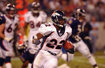 BALTIMORE - SEPTEMBER 30:  Running back Gary Olandis #22 of the Denver Broncos carries the ball up the field during NFL Monday Night Football game against the Baltimore Ravens on September 30, 2002 at Ravens Stadium in Baltimore, Maryland. The Ravens defe