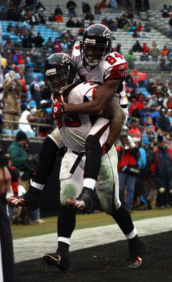 CHARLOTTE, NC - DECEMBER 12:  Teammates Roddy White #84 and Michael Turner #33 of the Atlanta Falcons celebrate after Turner scored a touchdown against the Carolina Panthers during their game at Bank of America Stadium on December 12, 2010 in Charlotte, N