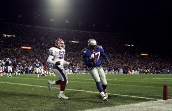 29 Nov 1998:  Running back Robert Edwards #47 of the New England Patriots in action against linebacker Sam Cowart #56 of the Buffalo Bills during a game at Foxboro Stadium in Foxboro, Massachusetts. The Patriots defeated the Bills 25-21. Mandatory Credit: