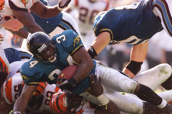 11 Nov 2001 : Stacey Mack #34 of the Jacksonville Jaguars takes a fall by a tackle of the Cincinnati Bengals during the game at Alltell Stadium in Jacksonville, Florida.  The Jaguars won 30-13. DIGITAL IMAGE. Mandatory Credit: Andy Lyons/Allsport