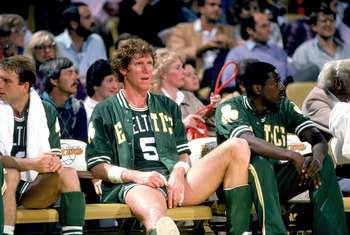 1985: Bill Walton #5 of the Boston Celtics rest on the bench during a game circa 1985. (Photo by Rick Stewart/Getty Images)